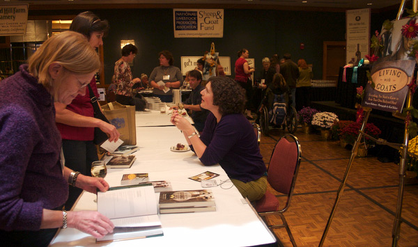 Margaret talks to Gianaclis Caldwell of Pholia Farm in Rogue River, Oregon, during the wine and cheese and book signing event at the ADGA National Convention in Buffalo.