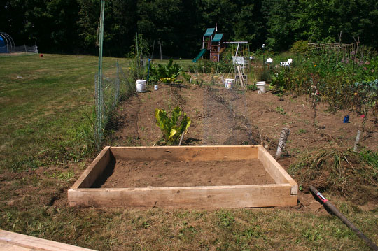 The raised bed, finished and ready to have the top and hoop attached.