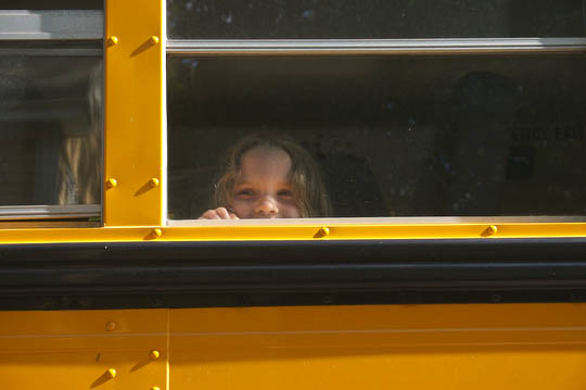 Charlotte rides the bus to her first day of camp.
