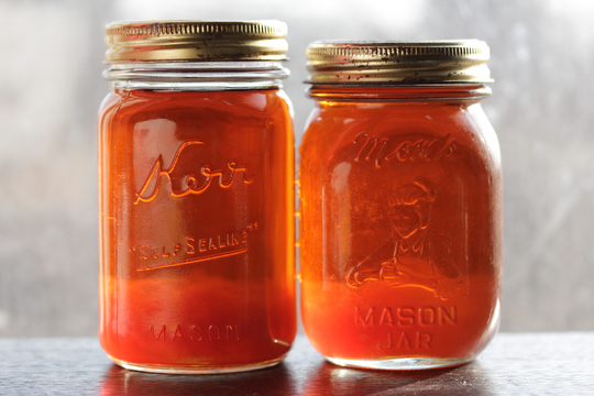 A couple of self sealed jars of this year's first batch of maple syrup