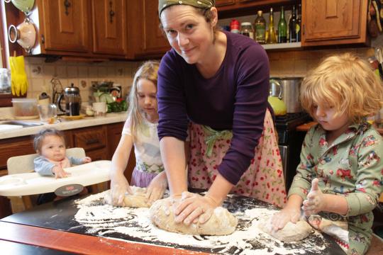 Margaret and the girls make challah for Rosh Hashana