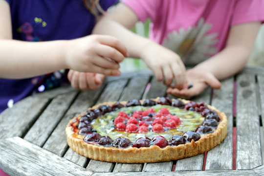 Charlotte & Bea put the finishing touches on the tart
