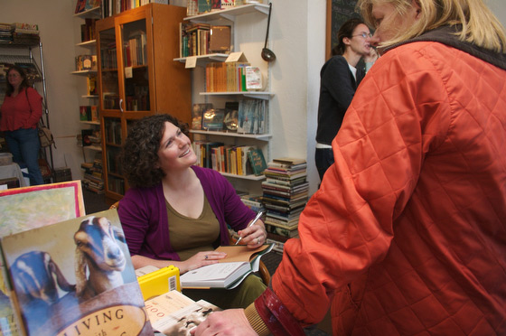 Margaret signs copies of the new book, Living With Goats