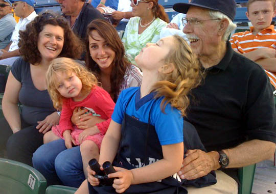 Margaret, our Israeli camp counselor Yuval, Grampa Steve, and the girls take in a Sea Dogs game.
