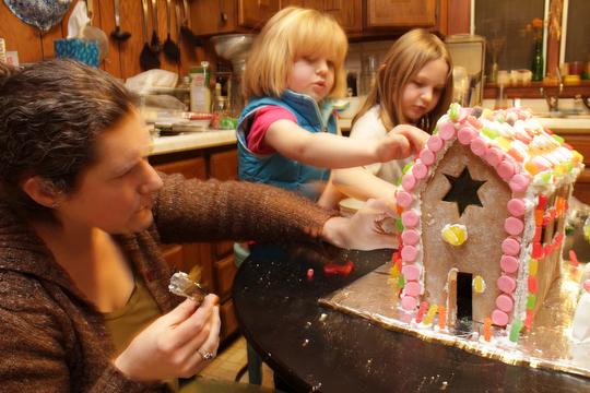 Margaret, Beatrice and Charlotte carefully decorate