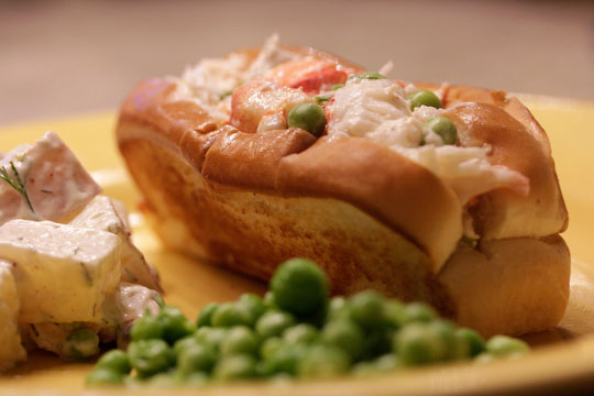 Peas three ways: sautéd in butter, potato salad with fresh peas, and lobster roll with peas